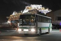 Buses carrying some European passengers from the quarantined Diamond Princess cruise ship leaves a port in Yokohama, near Tokyo, on Feb. 21, 2020. (AP Photo/Eugene Hoshiko)