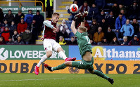 Bournemouth goalkeeper Aaron Ramsdale, right, saves a shot from Burnley's Matej Vydra during their English Premier League soccer match at Turf Moor in Burnley, England, Saturday Feb. 22, 2020. (Martin Rickett/PA via AP)