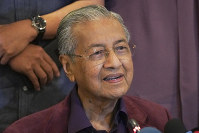 In this Feb. 22, 2020, file photo, Malaysian Prime Minister Mahathir Mohamad, speaks during a press conference in Putrajaya, Malaysia. (AP Photo/Vincent Thian)