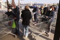 People queue outside a supermarket in Casalpusterlengo, northern Italy, on Feb. 24, 2020. (AP Photo/Paolo Santalucia)
