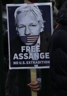 A supporter holds a placard which reads 'Free Assange' as she protests against the extradition of Wikileaks founder Julian Assange outside Belmarsh Magistrates Court in London, on Feb. 24, 2020. (AP Photo/Matt Dunham)