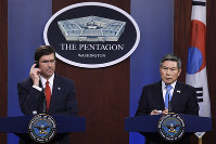 Defense Secretary Mark Esper, left, listens as South Korean National Defense Minister Jeong Kyeong-doo, right, speaks during a news conference at Pentagon in Washington, on Feb. 24, 2020. (AP Photo/Susan Walsh)