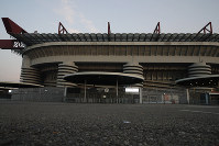 This photo shows a view of the San Siro stadium where the Serie A soccer match between Inter and Sampdoria was cancelled, in Milan, Italy, on Feb. 23, 2020. (AP Photo/Antonio Calanni)