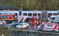 Emergency cars and police are standing at the station in Idar-Oberstein, Germany, on Feb. 26, 2020 after a regional train with about 70 passengers was stoped on suspicion of coronavirus. (Sebastian Schmitt/dpa via AP)