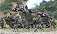 In this July 6, 2016, file photo, South Korea and U.S. marines participate in a joint military exercise between South Korea and the United States in Pohang, South Korea. (Kim Joon-bum/Yonhap via AP)