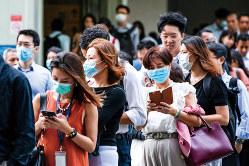 世界中に飛び火した新型肺炎(Bloomberg)