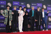 In this Jan. 5, 2020 file photo, members of South Korean K-Pop group BTS pose for photos during the Golden Disk Awards in Seoul, South Korea. (AP Photo/Ahn Young-joon)