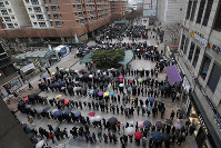 People line up to buy face masks outside a department store in Seoul, South Korea, on Feb. 28, 2020. (AP Photo/Lee Jin-man)