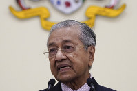 Malaysian interim leader Mahathir Mohamad speaks during a press conference at his office in Putrajaya, Malaysia, on Feb. 27, 2020. (AP Photo/Vincent Thian)