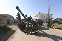 Turkish backed Syrian rebels enter the town of Saraqeb, in Idlib province, Syria, on Feb. 27, 2020. (AP Photo/Ghaith Alsayed)
