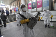 Workers wearing protective gears spray disinfectant as a precaution against the new coronavirus at a subway station in Seoul, South Korea, on Feb. 28, 2020. (AP Photo/Ahn Young-joon)