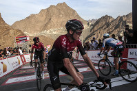 Britain's Chris Froome of Ineos Team crosses the finish line after the second stage of the UAE cycling tour in Dubai, United Arab Emirates, on Feb, 24, 2020. (AP Photo/ Mahmoud Khaled)
