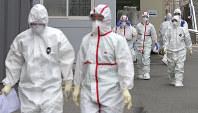 Medical staff in protective gear arrive for a duty shift at Dongsan Hospital in Daegu, South Korea, on Feb. 28, 2020. (Ryu Hyung-seok/Yonhap via AP)