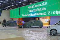 Cars are pictured as workers stop the preparation of the 90th Geneva International Motor Show, GIMS, at Palexpo, in Geneva, Switzerland, on Feb. 28, 2020. (Salvatore di Nolfi/Keystone via AP)