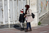 People walk as they wear masks in downtown Tehran, Iran, on Feb. 27, 2020. (AP Photo/Vahid Salemi)