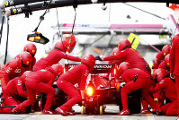 Pit crew work on the car of Ferrari driver Charles Leclerc of Monaco as he pulls into the pits during the Formula One pre-season testing session at the Barcelona Catalunya racetrack in Montmelo, outside Barcelona, Spain, on Feb. 28, 2020. (AP Photo/Joan Monfort)
