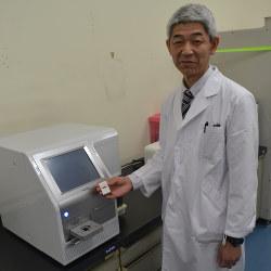 がんの種類判別は今後の課題(マイクロRNAチップを持つ東芝の橋本幸二研究主幹)
