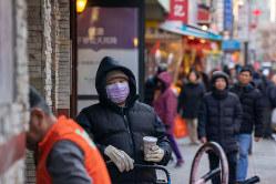 ニューヨーク近隣のチャイナタウン。ウイルスが古い偏見を復活させるとの懸念も(Bloomberg)