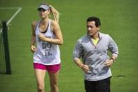 Maria Sharapova and Yutaka Nakamura are seen running together in this photo provided by Yutaka Nakamura.