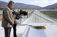 Toshinori Fujita and his wife Hidemi, from Takamatsu in western Japan, are seen praying for their eldest daughter, who died in the tsunami after the 2011 Great East Japan Earthquake. She was living in Rikuzentakata in Iwate Prefecture, where she had moved after getting married. Praying for her in the same city, her parents said,