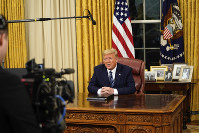 U.S. President Donald Trump speaks in an address to the nation from the Oval Office at the White House about the coronavirus on March, 11, 2020, in Washington. (Doug Mills/The New York Times via AP, Pool)