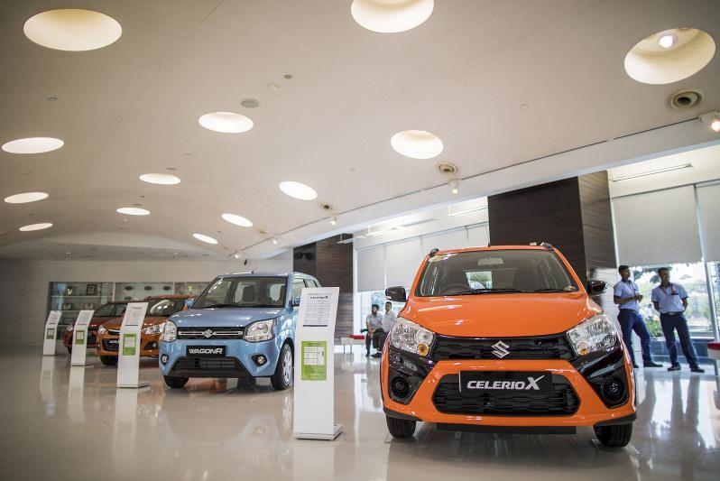 自動車販売は1年以上、前年を割り込んでいる(Bloomberg)