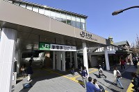 The new building of JR Harajuku Station is seen in Tokyo's Shibuya Ward on March 21, 2020. Pictured at rear is the station's old building. (Mainichi/Tatsuya Fujii)
