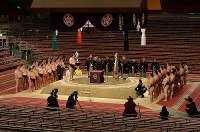 The March Grand Sumo Tournament award ceremony is held without spectators at Edion Arena Osaka on March 22, 2020, in Osaka. It is very unusual to have the wrestlers stand around the ring for the ceremony. (Mainichi/Kenji Konoha)