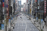 The Ginza shopping district in Tokyo's Chuo Ward is seen nearly deserted on March 28, 2020, after the metropolitan government called on residents to refrain from going outside over the weekend due to the spread of the new coronavirus. (Mainichi/Toshiki Miyama)
