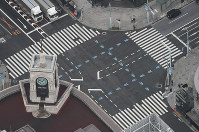 In this photo taken from a Mainichi Shimbun helicopter, a major intersection in the Ginza shopping district in Tokyo's Chuo Ward is seen almost deserted on March 28, 2020, after the metropolitan government called on residents to refrain from going outside over the weekend due to the spread of the new coronavirus. (Mainichi/Yuki Miyatake)