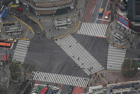 In this photo taken from a Mainichi Shimbun helicopter, fewer pedestrians than usual are seen crossing the
