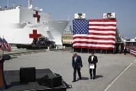 President Donald Trump and Defense Secretary Mark Esper arrive to speak in front of the U.S. Navy hospital ship USNS Comfort at Naval Station Norfolk in Norfolk, Va., on March 28, 2020. (AP Photo/Patrick Semansky)