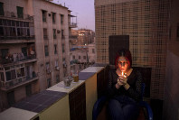 In this Oct. 28, 2019 photo, Egyptian transgender woman and activist Malak el-Kashif smokes a cigarette in the balcony of her apartment in Cairo, Egypt. (AP Photo/Nariman El-Mofty)