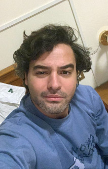 Andrea Napoli, 33, takes a selfie in a hotel being used for patients recovering from coronavirus, in Rome, on March 29, 2020. (Andrea Napoli via AP)