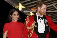 In this March 7, 2020 file photo, Britain's Prince Harry and Meghan, Duchess of Sussex arrive at the Royal Albert Hall in London. (Simon Dawson/Pool via AP)