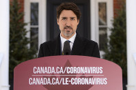 Canadian Prime Minister Justin Trudeau addresses Canadians on the COVID-19 pandemic from Rideau Cottage in Ottawa, Ontario, on March 27, 2020. (Sean Kilpatrick/The Canadian Press via AP)