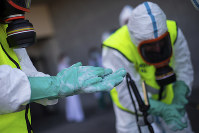 Spanish Royal Guard soldiers are seen during disinfection work to prevent the spread of the new coronavirus at a hospital in Madrid, Spain, on March 29, 2020. (AP Photo/Bernat Armangue)