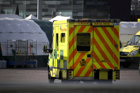 Ambulances and camp tents are seen outside the Excel in London, on March 28, 2020. (AP Photo/Alberto Pezzali)