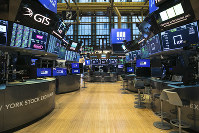 This photo provided by the New York Stock Exchange shows the unoccupied NYSE trading floor, closed temporarily for the first time in 228 years as a result of coronavirus concerns, on March 24, 2020. (Kearney Ferguson/NYSE via AP, File)