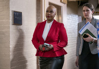 In this March 11, 2020, file photo, Rep. Ayanna Pressley, D-Mass., and other House Democrats arrive to meet with Speaker of the House Nancy Pelosi, D-Calif., on Capitol Hill in Washington. (AP Photo/J. Scott Applewhite)