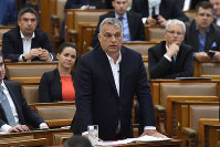 Hungarian Prime Minister Viktor Orban replies to an oppositional MP during a question and answer session of the Parliament in Budapest, Hungary, on March 30, 2020. (Zoltan Mathe/MTI via AP)