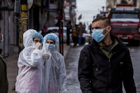 Medical workers oversee the disinfection of the streets to prevent the spread of coronavirus in Qamishli, Syria, on March 24, 2020. (AP Photo/Baderkhan Ahmad)