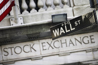 This July 16, 2013 file photo shows a street sign for Wall Street outside the New York Stock Exchange in New York. (AP Photo/Mark Lennihan)