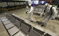 Sanitary workers disinfecting at the end of the day the Warszawa Zachodnia (Warsaw Western) coach station in a new routine intended to fight the spread of the coronavirus, in Warsaw, Poland, on March 25, 2020. (AP Photo/Czarek Sokolowski)