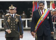 In this May 24, 2018 file photo, Venezuela's President Nicolas Maduro, right, walks with his Defense Minister Vladimir Padrino Lopez as they review the troops during a military parade at Fort Tiuna in Caracas, Venezuela. (AP Photo/Ariana Cubillos)