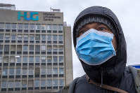 A person wearing protective face mask as a precaution against the spread of the coronavirus is seen at the Geneva University Hospitals in Geneva, Switzerland, on March 30, 2020. (Salvatore Di Nolfi/Keystone via AP)