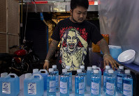 A street vender adjusts bottles of hand sanitizers amid the outbreak of the new coronavirus in Bangkok, Thailand, on April 2, 2020. (AP Photo/Gemunu Amarasinghe)