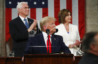 In this Feb. 4, 2020, this file photo, President Donald Trump look to the first lady's box before delivering his State of the Union address to a joint session of Congress in the House Chamber on Capitol Hill in Washington, as Vice President Mike Pence and Speaker Nancy Pelosi watch. (Leah Millis/Pool via AP)