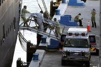 A person on a stretcher is carried from Carnival's Holland America cruise ship Zaandam at Port Everglades on April 2, 2020, in Fort Lauderdale, Florida. (AP Photo/Lynne Sladky)