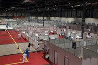 A general view a temporary field hospital set at Ifema convention and exhibition of in Madrid, Spain, on April 2, 2020. The new coronavirus causes mild or moderate symptoms for most people, but for some, especially older adults and people with existing health problems, it can cause more severe illness or death. (AP Photo/Manu Fernandez)